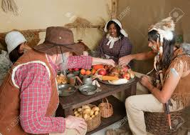 pilgrims and thanksgiving history reenactment scene of the first thanksgiving dinner in plymouth