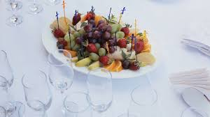canapes fruit table layout in a restaurant with fruit canapes and glasses of