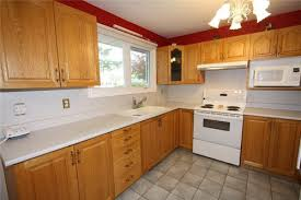 what color backsplash with honey oak cabinets downplay honey oak cabinets