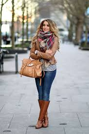 what to wear with light brown boots light brown leather jacket plaid scarf riding boots hair down