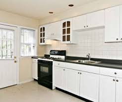 black and white kitchen backsplash backsplash tag white kitchen cabinets with granite island chairs