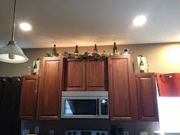 decorating above kitchen cabinets wine theme modern cabinets