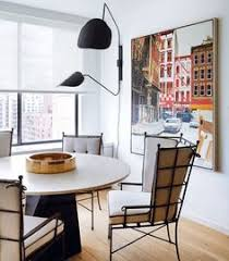 the den at dining in an architect turned fashion designer brings his modern aesthetic to