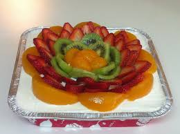tres leches cake with fruit tres leches cake topped with whipped