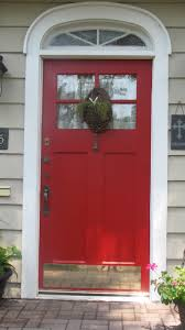 White Front Door Decorations Strong Red Tone In White Door Frame Of Wooden Wall