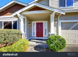 red front door entrance porch red front door house stock photo 513831559