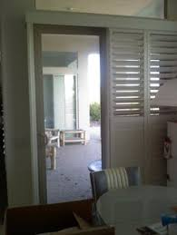 Plantation Shutters On Sliding Patio Doors by White Wooden Blinds For Patio Doors Wood Blinds Pinterest