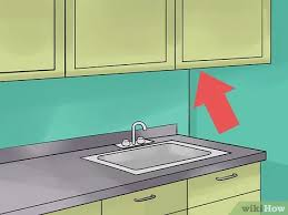 how to install lighting your kitchen cabinets how to install cabinet lighting with pictures wikihow