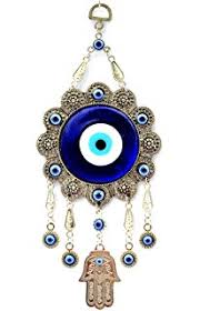 blue evil eye and hamsa hanging ornament with a