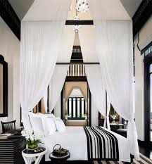 Black Canopy Bed Minimalist Bedroom With White Walls And Black Closets Also Using