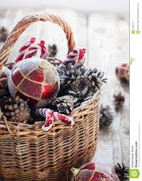 christmas vintage gifts in basket red gold balls pine cones