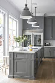 travertine countertops gray cabinets in kitchen lighting flooring