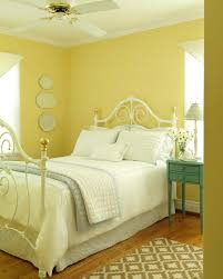 photos hgtv yellow cottage style bedroom with white iron bed