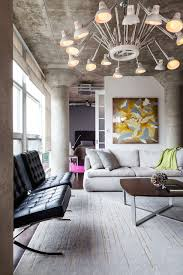 apartment concrete ceiling with artistic pendants and white rugs