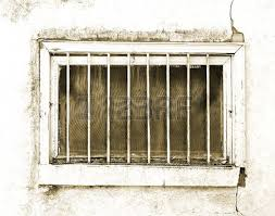 old exterior small basement window in desperate need of repair
