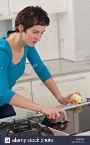 Cleaning Ceramic Glass Cooktop Woman Cleaning The Ceramic Glass Cooktop Stock Photo Royalty Free