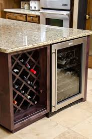 glass countertops kitchen island with wine fridge lighting