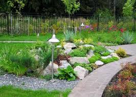 fantastic backyard with rock garden ideas also hanging flowers