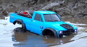 rc toyota hilux 4x4 goes off roading in the mud does a hell of a