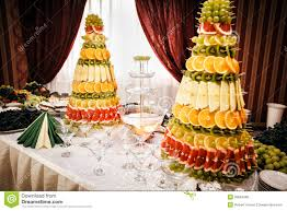 champagne fountain and decorations from fruit on table setting at
