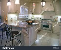 kitchen island with stove modern kitchen island table chairs stove stock photo 1423210