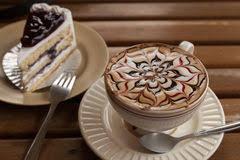 Beautiful Coffee Cup Of Capuchino Coffee With Chocolate Banana Cake Stock