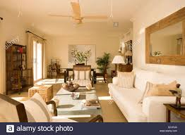 Ceiling Fans For Dining Rooms Large Wooden Mirror Above Cream Sofa In Modern Openplan Living And