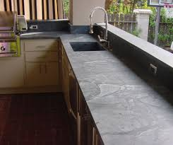 decorating beautiful soapstone countertops with white subway tile