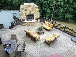 contemporary deck with outdoor fireplace u0026 fence in new city ny