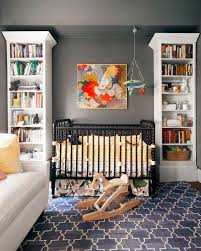 sophisticated nursery room with book shelves black crib and
