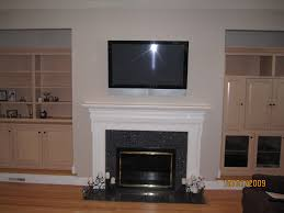 how to hide cords on wall mounted tv above fireplace fireplace ideas
