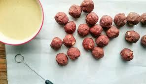 vegan macadamia ferrero style truffle with white chocolate