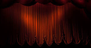 a red curtain stage opening and fading to black stock video