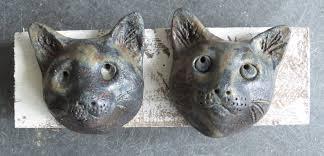 two cat heads wall plaque jane adams ceramics