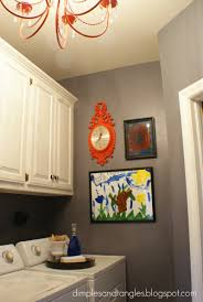 remodelaholic redecorated laundry room with chandelier paint