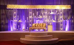 modern indian wedding ceremony with wide all floral mandap design