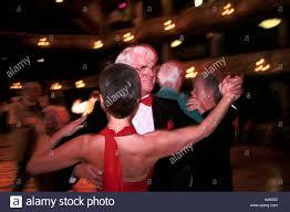 a couple ballroom dancing in the winter gardens blackpool uk