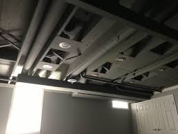cozy chic basement reno with exposed painted joists u0026 wood tile
