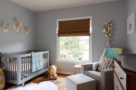 gray and blue contemporary nursery with feather chandelier