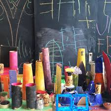 art city made by children using recycled materials inspired by