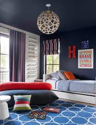 Red And Blue Boys Bedroom - orange and blue boy bedroom with white trundle bed transitional