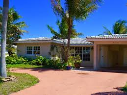dutch west indies estate tropical exterior miami tropical home on water with heated pool and vrbo