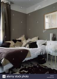 Grey Cream And White Bedroom Cream And Beige Cushions On Bed With White Bedlinen In Dark Grey