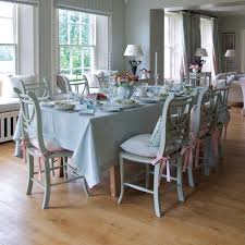 dining room wooden floor combine with dining table cloth and