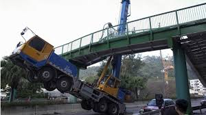 hong kong truck driver left hanging after crane smashes into