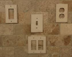 travertine light switch plates stone switchplates and outlet covers shown on a travertine