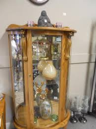 Antique Curio Cabinet With Clock Carved Lionhead Curio Cabinet With Curved Glass On 3 Sides