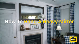 how to hang a heavy mirror youtube