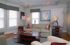 light gray walls light gray walls with wood trim living room transitional with