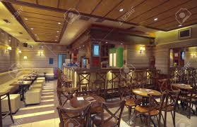 cafe interior with wooden furniture lighting equipment and